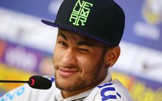 Brazilian striker Neymar winks during a press conference at the Brazilian Football Confederation training centre in Teresopolis. Brazil will face Colombia in their quarter final match in Fortaleza.