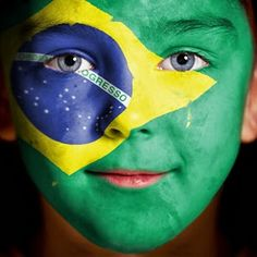 face painted with Brazilian flag