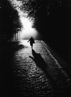 Photo: Sabine Weiss #Russian_Photo #rain #city #street long shadow, fading into the darkness, solitary light source creates that feeling of walking alone on a cold night as the darkness surrounds