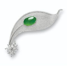 JADEITE AND DIAMOND 'LEAF' BROOCH Modelled as a whimsical leaf, set to the centre with a fine translucent oval jadeite cabochon of bright emerald green colour, amid a background pavé-set with brilliant-cut diamonds, highlighted by marquise-shaped diamonds, the diamonds together weighing approximately 5.00 carats, mounted in 18 karat white gold.