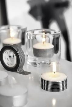 DIY Teelichter mit Masking Tape verschönern. DIY Idee für den monochromen Geburtstagstisch. Simple idea to dress up a dinner table, night lights, wasi tape and a glass holder. Simple