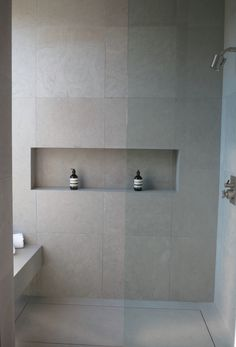 Neutral matte grey large scale tiles inspired by concrete for a modern bathroom ideas kitchens bathrooms . Tile Shower Shelf, Large Tile Bathroom, Recessed Shower Shelf, Bathroom Niche, Fitted Bathroom, Concrete Bathroom, Shower Niche, Modern Bathroom, Bathroom Ideas