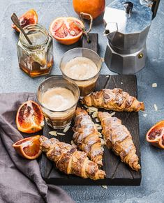 Traditional Italian style home breakfast. Latte in glasses, almond croissants and red bloody...