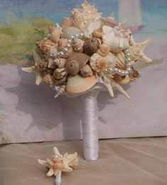 Why didn't I think of this earlier!? Starfish and Seashell Bouquet / by SlyCreationsBouquets on Etsy, $120.00