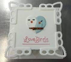 Royal icing love birds cake with collars