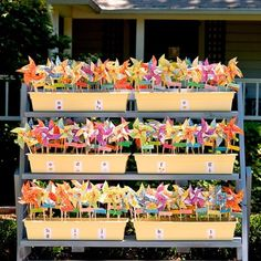 For a bright and breezy Spring wedding - pinwheels as escort cards