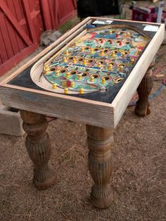 An old pachinko game was repurposed into a conversation-piece table. To make the transformation, ornate legs were simply fastened to the bottom of the game.