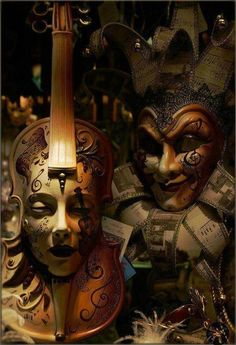 Venetian Carnival masks. Love the Violin Head one on the left.