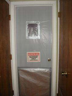My attempt at a cheap Asylum door for at the end of the hall. Paper, plastic, and duct tape
