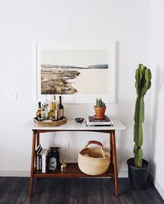 Tidied up the apartment this morning after a fun holiday weekend. This little corner in our dining room is becoming one of our favorites. Now we just have to find the perfect planter for this growing cactus! ☺️✨ http://liketk.it/2oIIf @liketoknow.it #liketkit #newdarlingsHOME