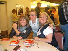 At a booksigning at Mt. Hermon Christian Writers Conference with our new friend Joules Evans.