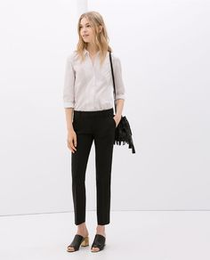 TROUSERS WITH SLIT AT THE HEM