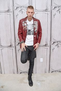 Connecting with AOL Build for its speaker series, Machine Gun Kelly is a style standout in a red leather jacket.