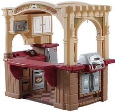 Step2 Grand Walk-In Kitchen & Grill - Play Kitchen with 103-Pc Play Accessories Set is a toy our 6 year old girl loves to play with. These are super popular toys!