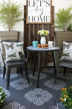 Breakfast on the farmhouse patio, loving the industrial metal chairs and shiplap wall!