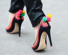 Pompom and crochet shoes -- because women want to look like an unbalanced, teetering piñata while walking down the street.
