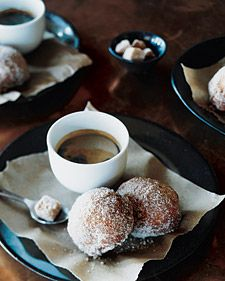 Bomboloni, which are Italian doughnuts, are dusted with spiced sugar and served with espresso.