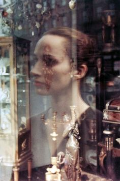 Saul Leiter. Untitled (reflection in antique store window), 1950.