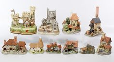 """Lot 497: David Winter Cottage Assortment; Ten buildings including """"Kent Cottage"""", """"Single Oast"""", """"Cornish Engine House"""", """"Cornish Harbor"""", """"The Guardian Gate"""", """"Tollkeepers Cottage"""", """"The Apothecary Shop"""", """"Haybarn"""", """"The Bothy"""" and """"St. Anne's Well"""""""