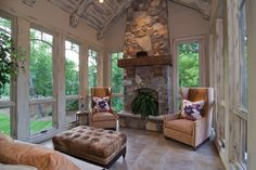 Four season Porch with heated floors. I just love the ceilings and fireplace. Walls and tile compliment each other well