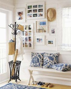 White foyer with blue accents/window frame picture collages// My son would kill me if I put that many pics up of him. Maybe if I pare it down a bit?