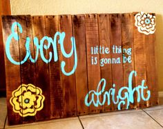 My very first pallete board sign.  I used my silihouette to make the vinyl stencils then I dabbed on paint.  The bottom left flower looks really yellow in the pic, but it's actually pale yellow. #bobmarley #palletboard