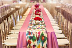 Colorful Table Runner -- See more here: http://www.StyleMePretty.com/southeast-weddings/2014/04/09/purple-southern-wedding-with-parisian-flare/ Photography: GlassJarPhotography.com