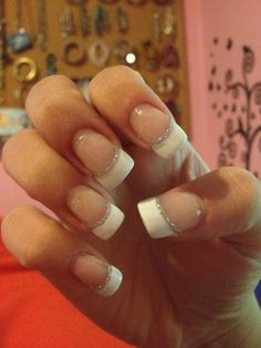 White french tip manicure with a silver line. Acrylic French tip design