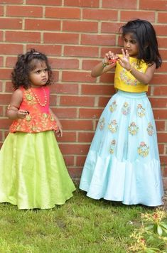 Beautiful powder blue color and green color lehenga with sunshine yellow and pink crop top with hand embroidery thread work. Frocks For Girls, Dresses Kids Girl, Kids Outfits, Baby Dresses, Baby Lehenga, Kids Lehenga, Bridal Lehenga, Kids Indian Wear, Kids Ethnic Wear