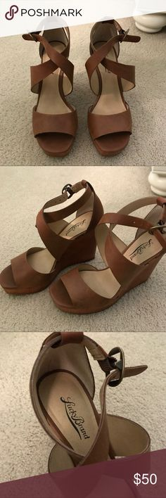 Lucky Brand Brown Wedges Only worn once for a photo shoot! Very comfy and great condition!! Size 7.5 Lucky Brand Shoes Wedges