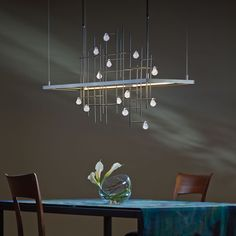The Spring LED Pendant Light is an abstract interpretation of falling drops from a fresh spring rain. http://www.ylighting.com/blog/hubbardton-forge-modern-lighting/