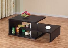 Enitial Lab Level Coffee Table, Espresso by Enitial Lab. $151.55. Assembly required by two adults; To clean, use damp cotton cloth to wipe clean; Made in China. Modern cut out design profile; ample bottom and top space for display; four silver finished support posts; posts accent supports. Our modern coffee table has an artful blend of form and function with its eye catching cut out design. Measures 47.25-inch wide by 24-inch deep by 16.25-inch high; 30-days hassle-free repla...