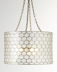 "EXCLUSIVELY OURS neiman. Metal frame accented with capiz. Gold-leaf finish on metal binding. Uses three 60-watt bulbs. 4.5""Dia. ceiling canopy included. Direct wire; professional installation required. Outdoor safe in a covered area. 22""Dia. x 13.5""T; 37""T with chain and canopy. Imported. Weight, 9.5 lbs. Boxed weight, approximately 20 lbs.  More ▾ COLOR: GOLD  Felicity Capiz Pendant Light  $395.00"