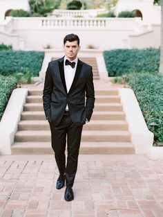 A classic black tux: http://www.stylemepretty.com/2016/03/09/contemporary-winter-wedding-inspiration-at-a-hollywood-hills-estate-2/ | Photography: Jon Cu - http://joncu.com/