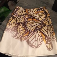 Hugo Boss Silk Monarch Butterfly Print Skirt Title describes this! So spring. The size is 0-2. I'm 5'2 and when it fit, it hit just at the knee. This was dry cleaned, dry cleaning tag still on it. I can leave on or remove. Hugo Boss Skirts