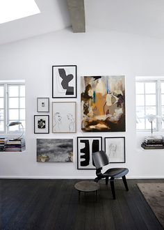 Not sure how to hang a gallery wall? Try using a large piece as an anchor for the other pieces and group the others around it.