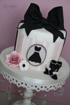 http://bit.ly/GUX0wZ A dress cameo with the biggest black ribbon ever, on the pale pink and white hat box cake. And aren't those mini black high heels too cute? http://media-cache3.pinterest.com/upload/40250990389143311_YvDItnM3_f.jpg SassaGirl gorgeous cakes
