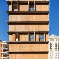 Perforated screens cover the facade of São Paulo   apartment block by Studio MK27