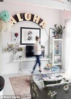 The Aloha light, a restored Blackpool illumination from Sideshow Interiors (sideshowinteriors.co.uk), bathes the space in a magical glow at ...