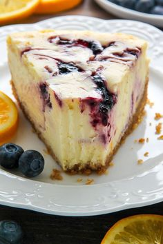 homemade graham cracker crust Supremely smooth and creamy homemade Lemon cheesecake topped with fresh Blueberry swirls. All layered on top of a buttery homemade graham cracker crust. Lemon Blueberry Cheesecake, Blueberry Desserts, Lemon Cheesecake, Cheesecake Recipes, Dessert Recipes, Summer Cheesecake, Cheesecake Crust, Kitchen Impossible, Homemade Graham Cracker Crust