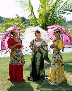 Women dressed in native Filipina costumes.  I used to dance traditional Philippine folk dances