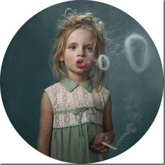 Glamour shots of smoking children. here i don't thank you for smoking. it is a dirty habit, i admit, as shown by these precocious looking tots. images are (supposed to be) part of an anti-smoking campaign. Craig Tracy, Planet Hemp, Smoking Photos, Smoking Images, Janssen, Funny Commercials, Funny Ads, Diane Arbus, Kids Series
