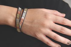 Gold, silver and copper beaded wrap bracelet. $7.00, via Etsy.