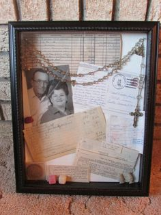 I made this for my Dad for Father's Day. It is a shadow box full of things that belonged to his parents plus a photo of them. (Rosary, sugar cube candy from WWI, a postcard from Rome, an 1881 coin, receipts, a handwritten checkbook register, a rock & two arrowheads, and an angel pin). Everything in there has a special meaning to my dad. Memory Box.