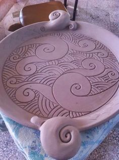 Love the curves. Carving, engraving, platter, handle.