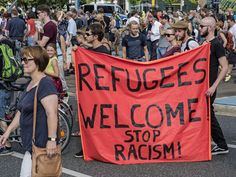 migrant crisis protest signs - Google Search