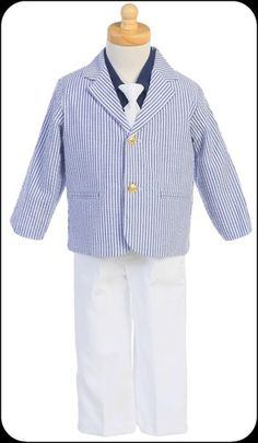 A soft, breezy seersucker cotton blazer in navy blue and white stripes will keep him comfortably cool; featuring a classic notched lapel and welt pockets it sits atop a long sleeve navy dress shirt, white elastic waist slacks and a solid white necktie, making a dashing suit ensemble.