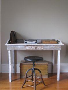 reclaimed wood desk, vintage stool, classic typewriter