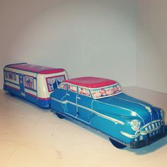 Vintage Wolverine tin litho toy car and trailer.