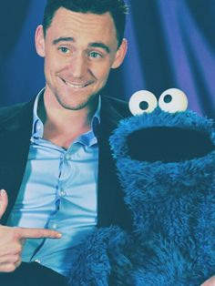 Tom Hiddleston meets Cookie Monster possibly best pic ever! (Does a muppet count as a baby animal? Eh, who cares, I'm counting it! hehehe)